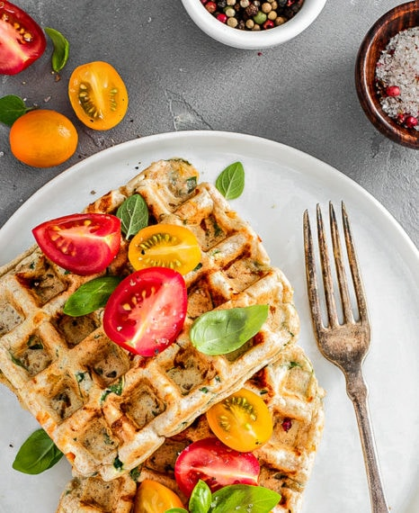 Vegetable and cheese savory waffles with tomatoes and herbs